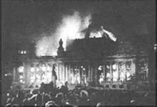Fire partly destroys the Reichstag building.  The government takes the occasion to step up persecution of the opposition parties.