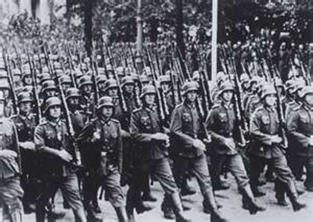 German troops march into the demilitarized Rhineland.
