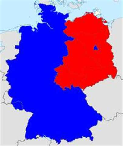 The Allies approve a constitution for western Germany (Federal Republic of Germany) and East Germany adopts a Communist-prepared constitution.