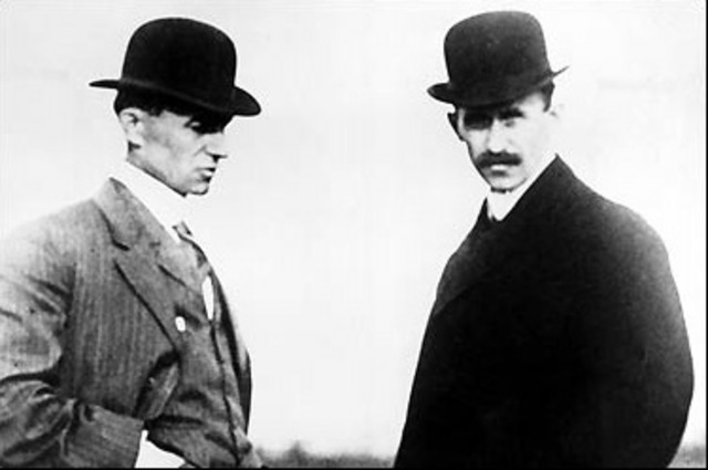 Orville and Wilbur Wright fly the airplane.