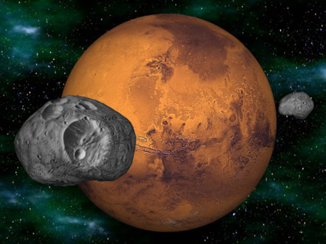 Asaph Hall discovers Martian moons