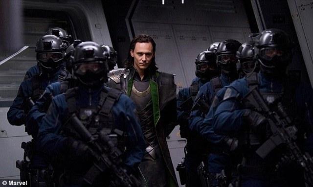 Loki is escorted back to SHIELD base.