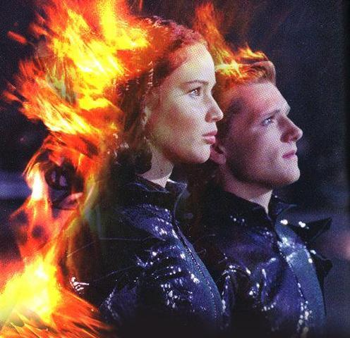 The opening ceremony begins. Katniss and Peeta are on fire!