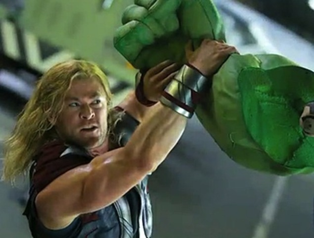 Thor tries to calm Hulk but both eventually fall out of the ship back to land.