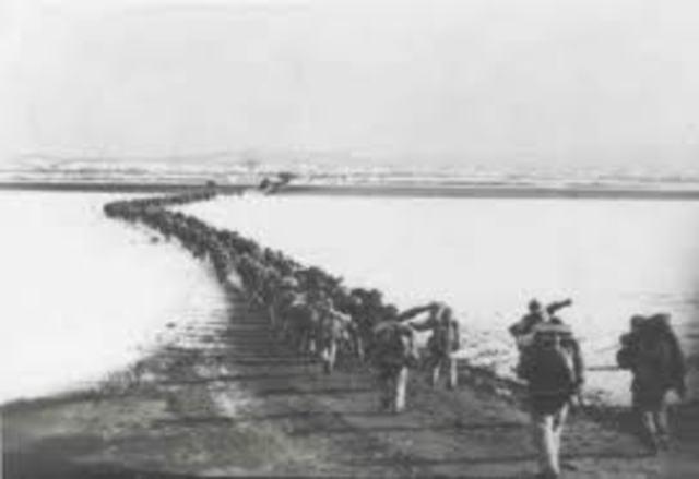 Chinese Communist troops cross Yalu River into Korea