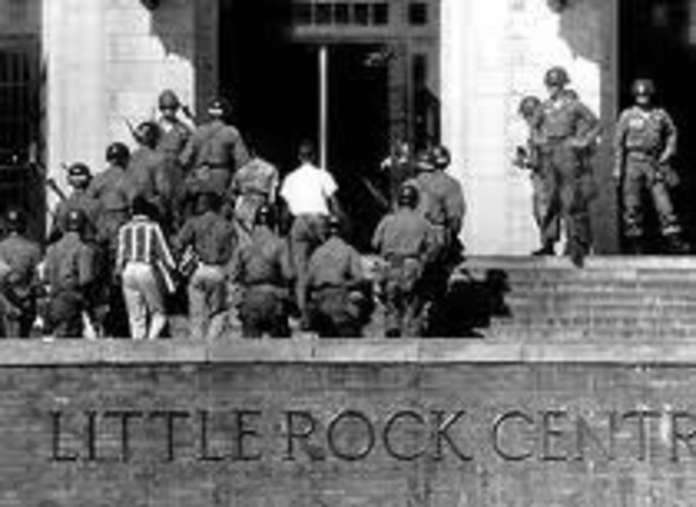 Governor Farbus of Arkansas brings in National Guard to prevent black students from going into a white school.