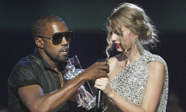 Kanye West takes Taylor Swift's microphone during her acceptance speech at the 2009 MTV Music Video Awards