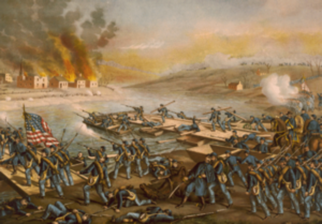 Battle of Fredricksburg, Union Maj. General Ambrose Burnside suffers 12,000 casualties in frontal assaults against Robert E. Lee's entrenched Confederate Army