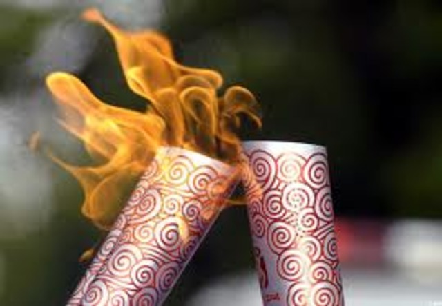 Premier relais de la flamme olympique