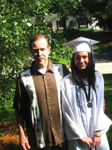 High School graduation ceremony. Here I am with my grandpa before the ceremony.