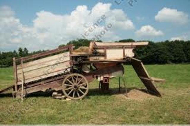 threshing machine invented