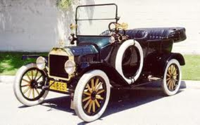 Ford mass-produces Model T-Ford automobiles on an assembly line
