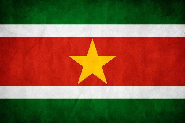 """Firma del """"Acuerdo para la Reconciliación y el Desarrollo Nacional"""" entre Suriname y grupos armados."""
