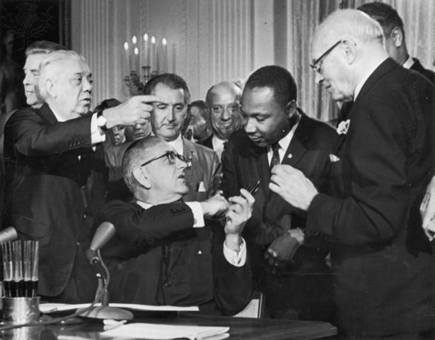 Pres. Lyndon Johnson signs the Civil Rights Act
