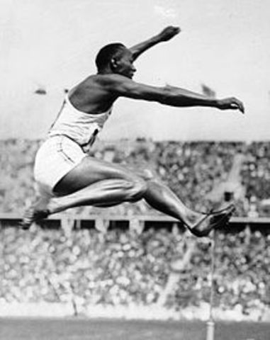 Jessie Owens wins four gold medals at the Berlin Olympics