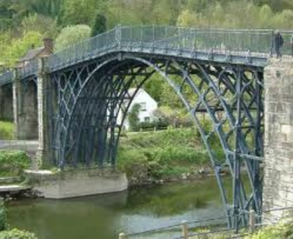 The first cast iron bridge is built in England