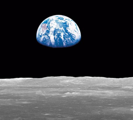 Crew Members of Apollo 8 first orbit the Moon