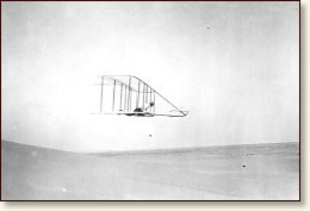 The wright brothers fly the first motor-driven airplane
