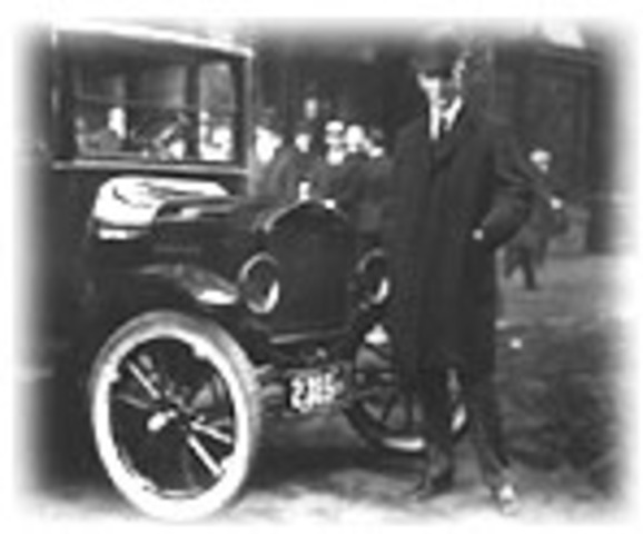 Henry Ford mass-produces Model T-Ford automobiles on an assembly line