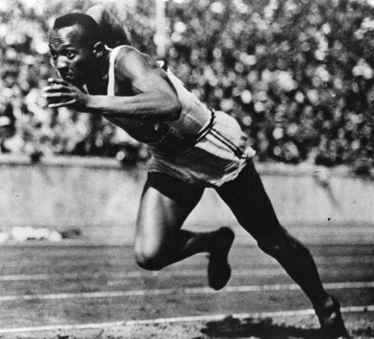 Jesse Owens wins gold in Berlin Olympics