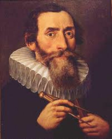 Kepler discovers laws of planetary motion