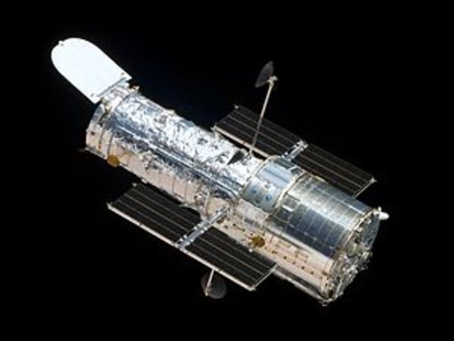 Discovery, Launch of the Hubble Space Telescope.  發現號傳送哈伯太空望遠鏡