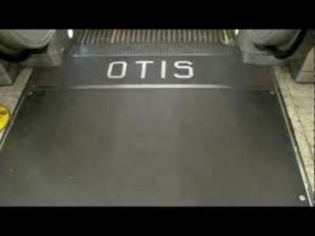Otis's first step-type escalator made for public use, is installed at the Paris Exhibition
