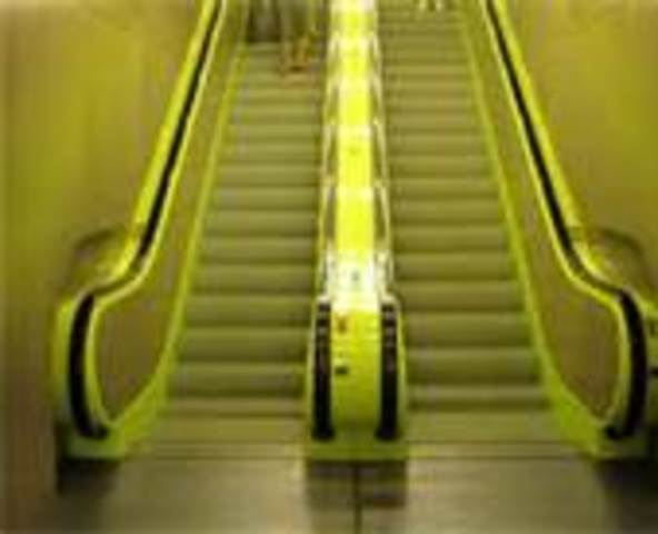 Otis engineers, led by David Lindquist, add improvements resulting in today's escalator