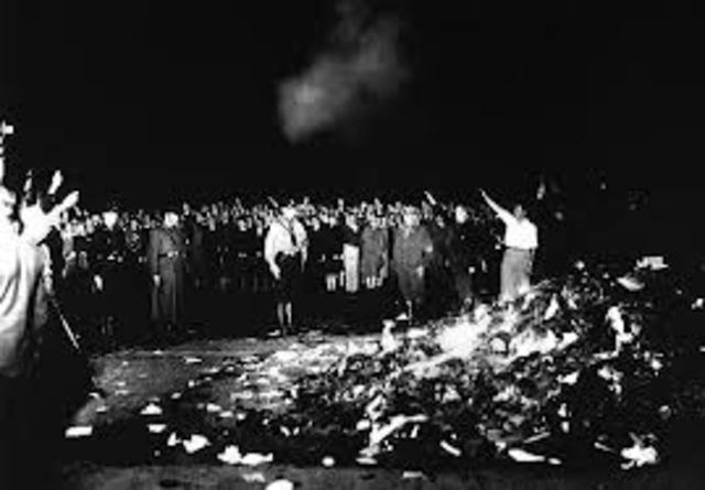 Nazis burn books of those considered un-German.  This introduces the idea of censorship and government control of culture.