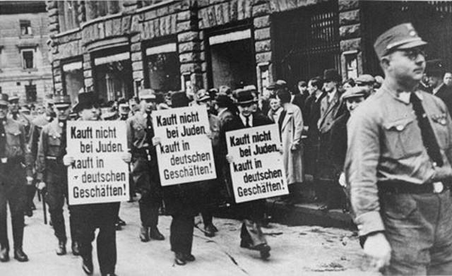 Nazis organixe a boycott of jewish-owned buisnesses