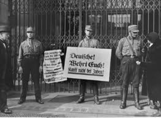 A nationwide boycott of Jewish-owned businesses in Germany is carried out under Nazi leadership.