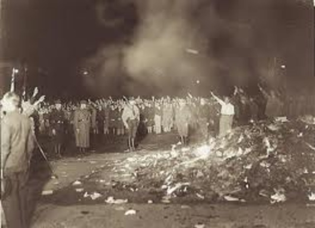 Books by Jews are burned publicly.