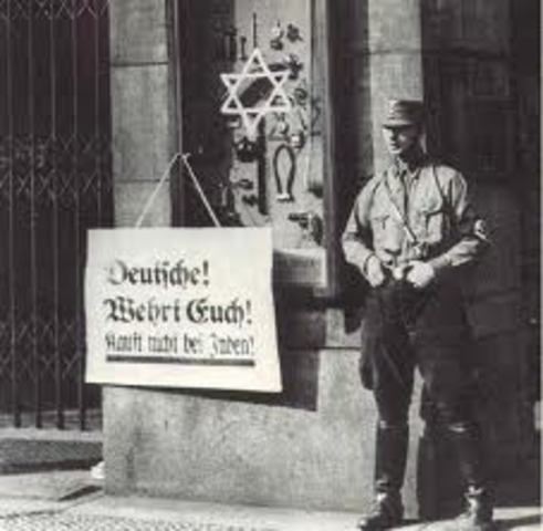 A nationwide boycott of Jewish-owned businesses in Germany is carried out under Nazi leadership