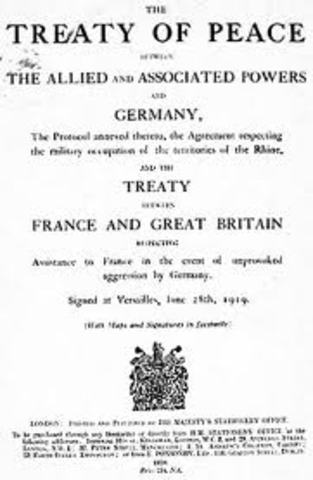 Hitler violates the Versailles Treaty by renewing the compulsory military draft
