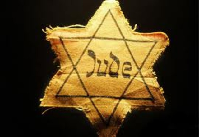The German government announces Jews must carry identification cards