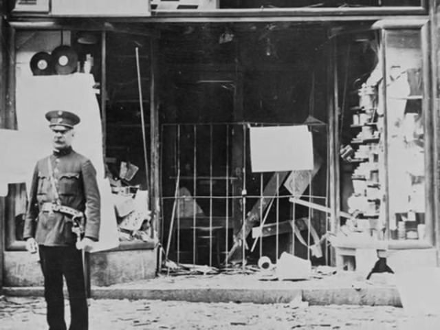 """Kristallnacht (""""Night of Broken Glass""""): Nazi organized nation-wide pogroms result in the burning of hundreds of synagogues; the looting and destruction of many Jewish homes, schools, and community offices; vandalism; and the looting of 7,500 Jewish store"""