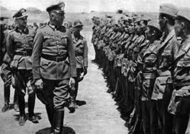 Hitler violates teh Versailles Treaty by renewing the compulsory military draft.