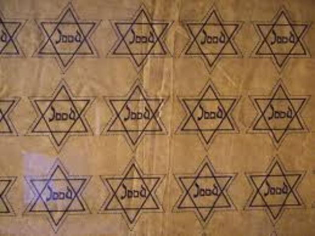 Jews in France and the Netherlands are required to wear identifying Stars of David.