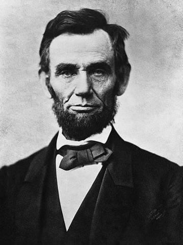 Lincoln signs first Draft Law