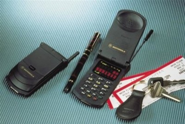 The clamshell flip phone is invented
