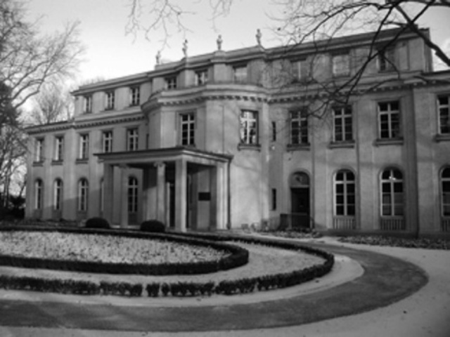 """Fifteen Nazi and government leaders meet at wannsee, a section of Berlin, to discus the """"final solution the the Jewish question."""""""