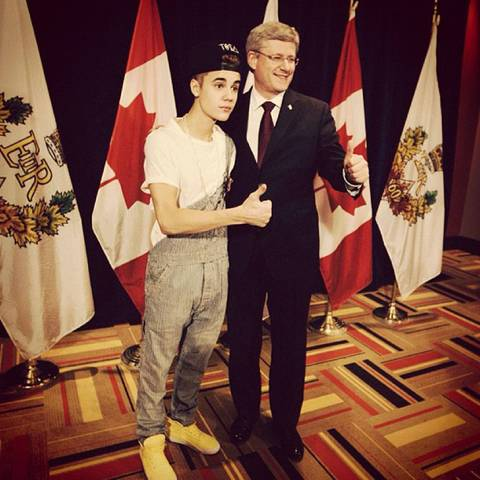 Wears overalls to meet Canadian PM