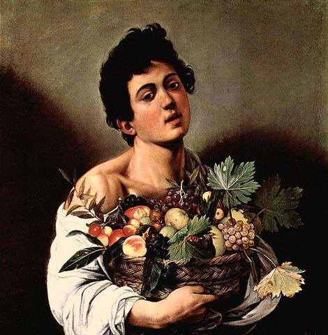 Muchacho con cesto de frutas