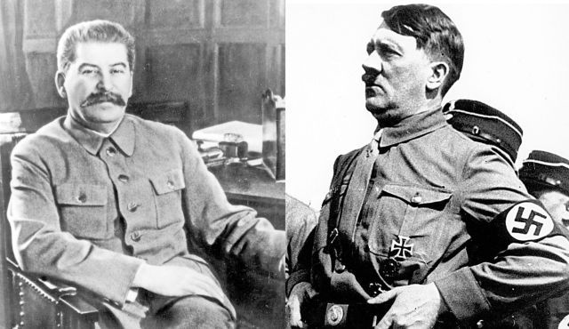 Joseph Stalin and Adolf Hitler sign the Nazi-Soviet Pact.
