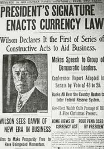 President Wilson signs the Federal Reserve Act