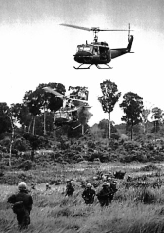 US commits troops to South Vietnam