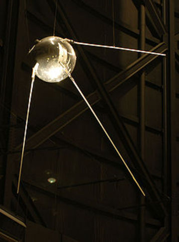 The Soviets successfully launch Sputnik into orbit