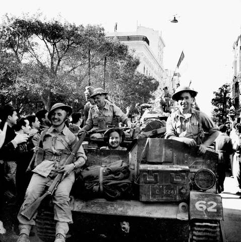 British and US forces defeat German and Italian armies in North Africa
