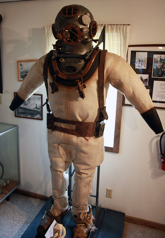 German-born inventor Augustus Siebe seals the Deanes brothers diving helmet.