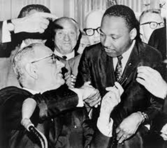 Johnson Signs Voting Rights Act of 1965